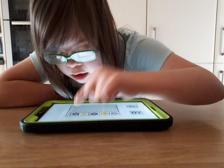 Girl using Special Numbers on Android tablet