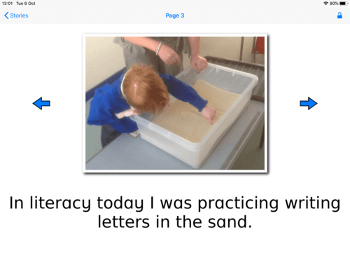 "Example of Special Stories with photo of boy writing in sand. Story reads ""In literacy today I was practicing writing letters in the sand."""